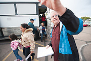 Pastor Jack Marslender welcomes refugees as they are being dropped off by ICE at the First Southern Baptist Church of Avondale on December 27, 2018.