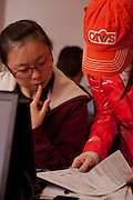 Student volunteer Lindsey Marginian (Right) assists international student Xiumin Jin of China complete her tax forms at a volunteer income tax assesment program offered by the College of Business at Ohio University.