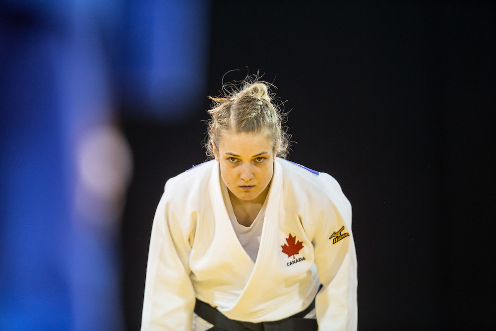 Kelita Zupancic of Canada bows before her contest against Vanessa Chala of Ecuador in the women's judo -70 kg 1/4 final at the 2015 Pan American Games in Toronto, Canada, July 13,  2015.  AFP PHOTO/GEOFF ROBINS