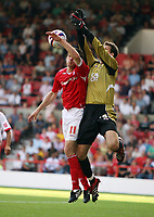 Photo: Rich Eaton. <br /> <br /> Nottingham Forest v AFC Bournemouth. Coca Cola Championship. 11/08/2007. Bournemouth keeper Asmir Begovic (r) outjumps Forest's Scott Dobie (l).
