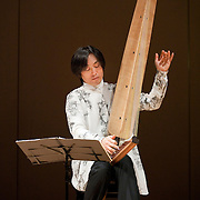"""February 18, 2012 - New York, NY : .Fuyuhiko Sasaki performs the World Premier of his self-composed 'To Be Human' (2012) on the kugo, an angular harp, during """"Resonances of the Kugo,"""" part of the 2012 New York Music From Japan Festival, at Merkin Concert Hall on Saturday. .CREDIT: Karsten Moran for The New York Times"""