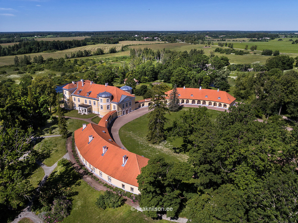 Kiltsi manor in Estonia. Aerial view, rooftop, green, trees. School. Old building, castle.
