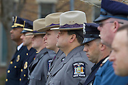 Goshen, New York - Police officers stand at attention during the Orange County Law Enforcement Officer Memorial Service on May 2, 2014. The memorial service honors the memory of the 27 members of the Orange County law enforcement community that died in the line of duty. The service also pays tribute the families and loved ones left behind for their courage, dignity and perseverance.