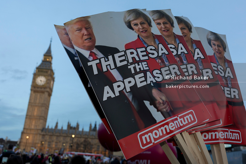 """As the British government debated US President Donald Trump's state visit to the UK, thousands of protesters gathered in large numbers against the trip which would potentially cost millions of Pounds in security alone, on 20th February 2017, in Parliament Square, London, UK. The visit comes after two online petitions received more than the 100,000 signatures required for such a debate to be considered in Parliament. A petition against the state visit got 1.85m signatures, while one supporting it got 311,000. Campaigners protested against the """"hatred, racism and division that Donald Trump is trying to create"""". Prime Minister Theresa May announced the state visit during her visit to Washington in January."""