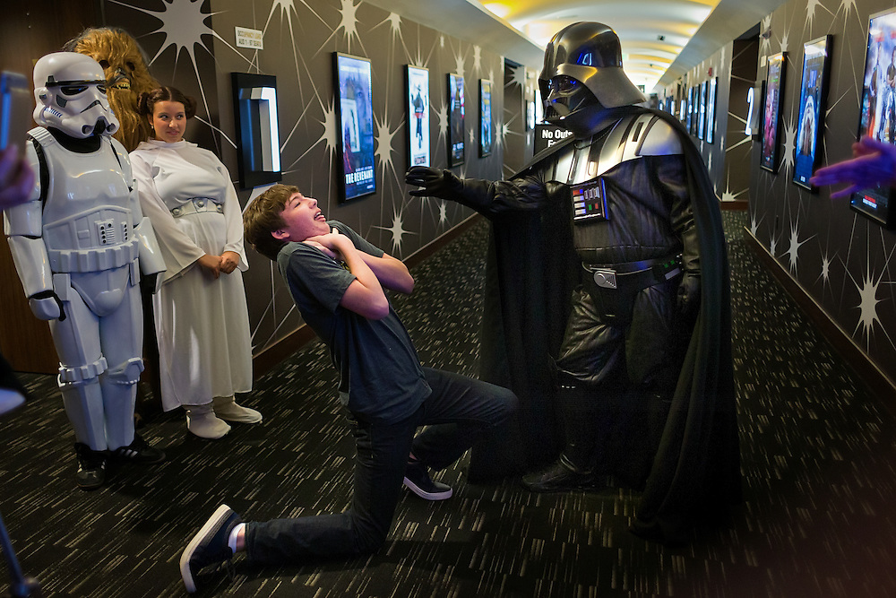 "Sixteen year-old Giovanni Fitzgerald, of Fort Myers, plays the role of one of Darth Vader's victims while arriving for the opening night of ""Star Wars: The Force Awakens"" at the Silverspot Cinema on Thursday, Dec. 17, 2015, in North Naples.  The theater welcomed Star Wars fans to the opening of the movie with costumed characters and Star Wars-themed cocktails."