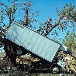 Scenes of devastation left in the aftermath of Hurricane Katrina that flooded the small city of Buras, Louisiana in Plaquemines Parish. A truck is lodged into a tree in Empire, Louisiana on August 29, 2005...(Mandatory Credit: Photo by Derick E. Hingle)