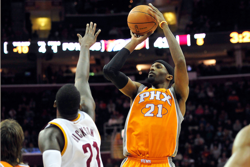 Jan. 19, 2011; Cleveland, OH, USA; Phoenix Suns power forward Hakim Warrick (21) shoots over Cleveland Cavaliers power forward J.J. Hickson (21) during the second quarter at Quicken Loans Arena. Mandatory Credit: Jason Miller-US PRESSWIRE