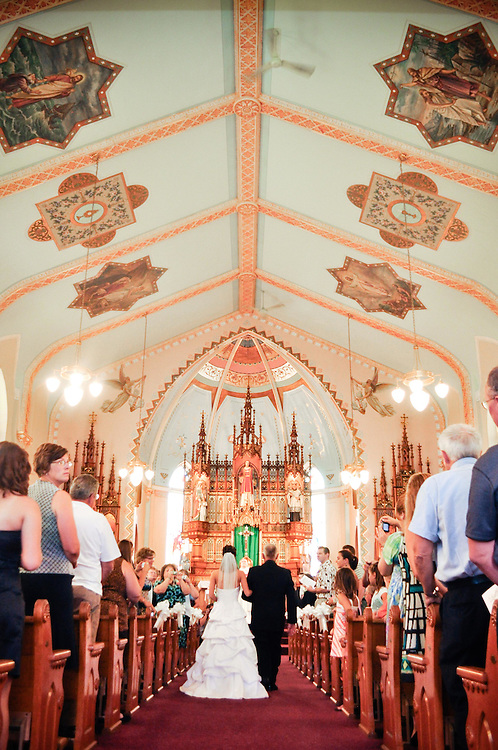 Amanda's father walks her down the isle at at St. Therese Catholic Church in Denmark, WI