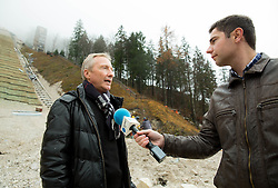 FIS Ski Jumping Race Director Walter Hofer and journalist of Planet TV Matej Podgorsek at visit of FIS representatives to inspect reconstruction of Planica's Ski Flying Hill, on November 11, 2014 in Planica Nordic centre, Slovenia. Photo by Vid Ponikvar / Sportida