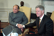 U.S President Bill Clinton meets with Pakistan Prime Minister Nawaz Sharif in the Oval Office of the White House December 2, 1998 in Washington, DC.