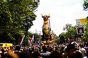 The bade (cremation tower) and The Lembu ( Giant Bull-shaped container for cremation ) marched to Dalem Puri Temple for Pelebon ceremony of Anak Agung Niang Rai of Puri Agung Ubud, The wife of King Of Ubud. Pelebon Ceremony or  Ngaben ceremony is a Hindu- Balinese ceremony to purify and return the  five element of the universe that form the life itself in human body to the universe.