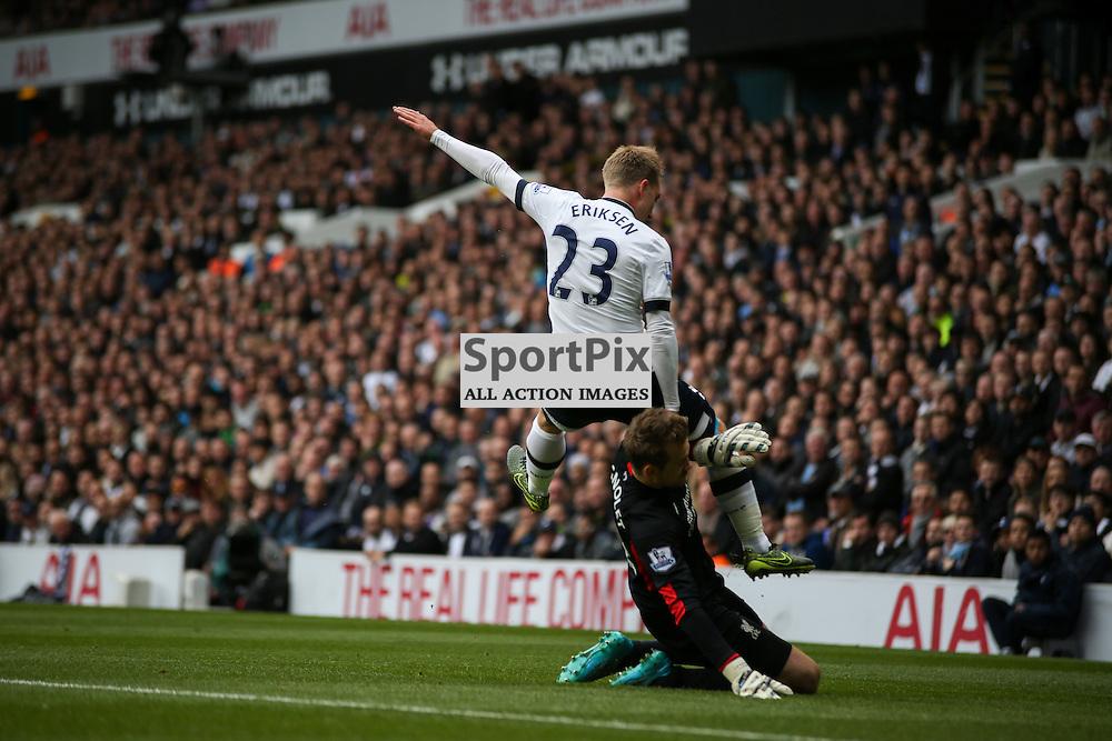 Simon Mignolet liverpool goalkeeper takes out Christian Eriksen Tottenham Hotspur vs Liverpool on Saturday 17th of October 2015.