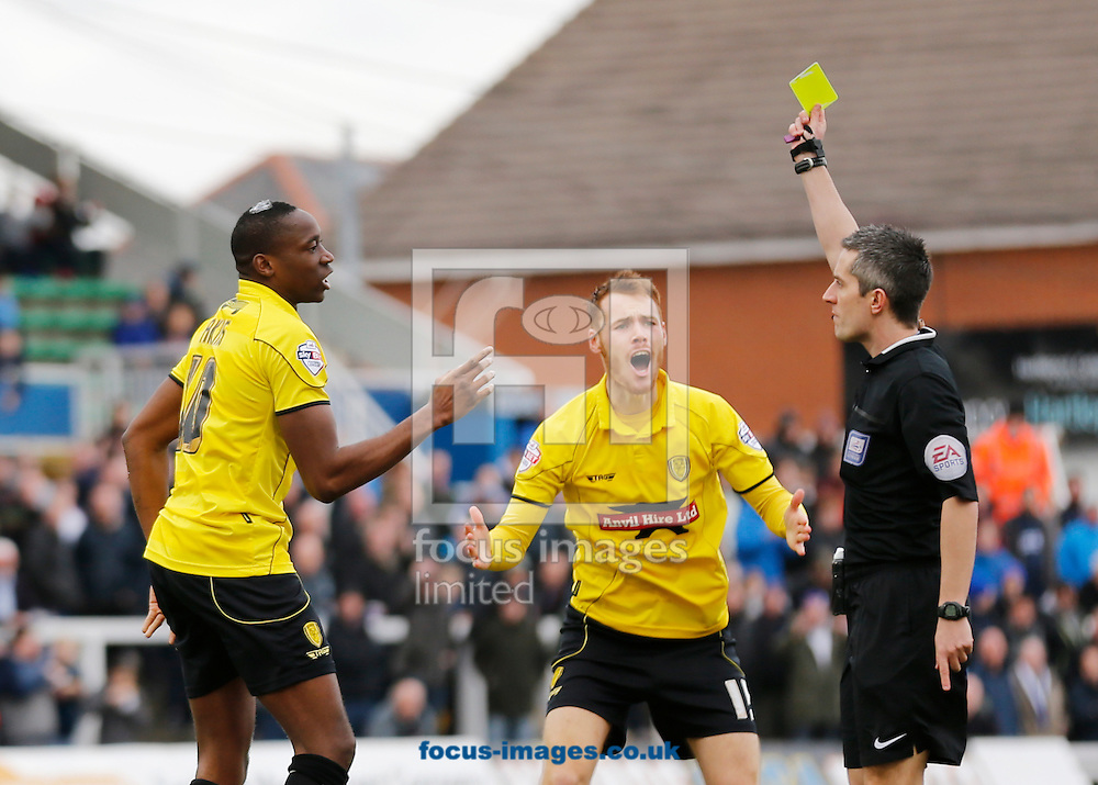 Lucas Akins (l) of Burton Albion receives a yellow card off referee Darren Bond (r) during the Sky Bet League 2 match at Victoria Park, Hartlepool<br /> Picture by Simon Moore/Focus Images Ltd 07807 671782<br /> 07/03/2015