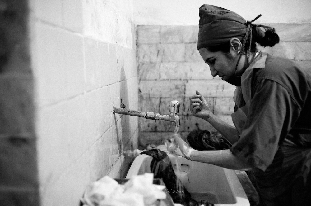 Doctor Shabana from Karachi scrubs up and gets ready to go into another surgery. Performing more then 20 operations in one day in very bad circumstances, the doctors are providing a much needed service to people who otherwise could not afford help. Thari Mirwah, Pakistan, 2010