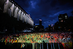 Fans react as they watch the World Cup soccer group H match between Spain and Chile, on a large screen outside the Santiago Bernabeu stadium in Madrid, on Friday, June 25, 2010. Millions of people worldwide are following the World Cup soccer tournament which is been held in South Africa, and broadcast to a diverse community of football fans. Spain won 1-2.