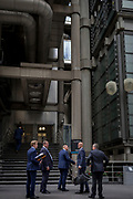 Businessmen in the Insrance industry part outside one of the entrances of Lloyds of London, on 11th August, 2017, in Lime Street, London, England.