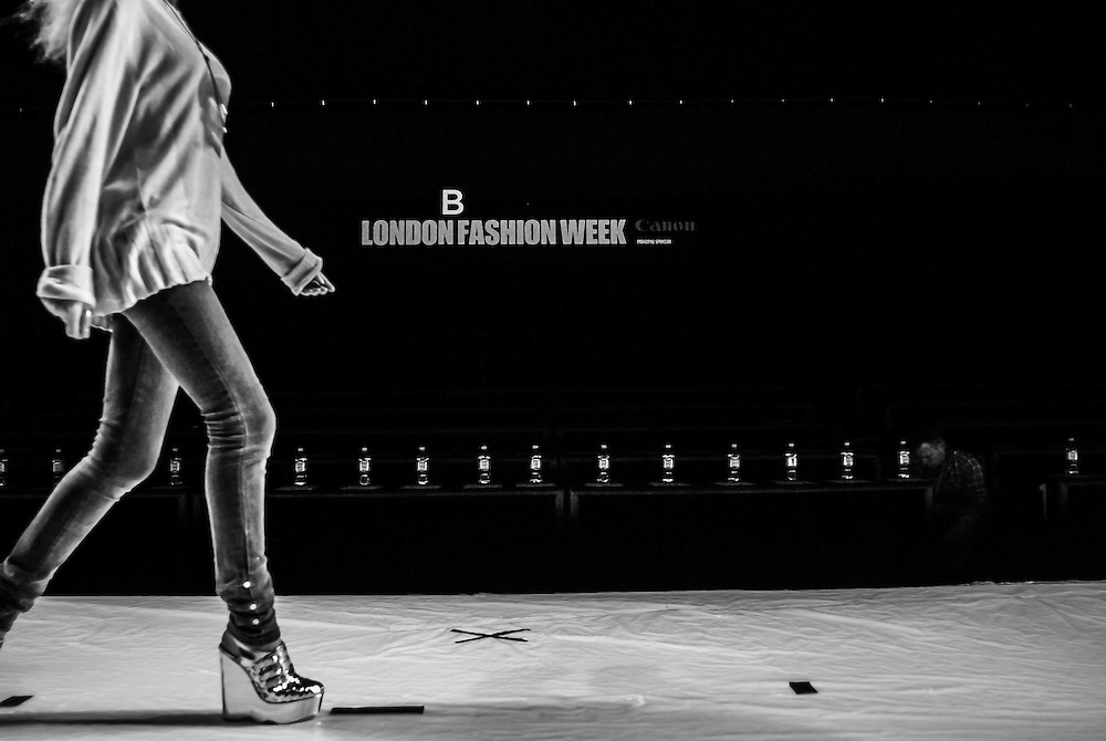 Models practice their walk in deathly heels ahead of the next runway show in Somerset House, London.