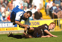 Foto: Digitalsport<br /> NORWAY ONLY<br /> SPORTSBEAT 01494 783165<br /> PICTURE ADY KERRY .<br /> MILLWALL VS READING<br /> MILLWALL'S  PAUL IFILL FLIES AFTER A CHALLENGES WITH READING'S STEVE SIDWELL , 24TH APRIL 2004.