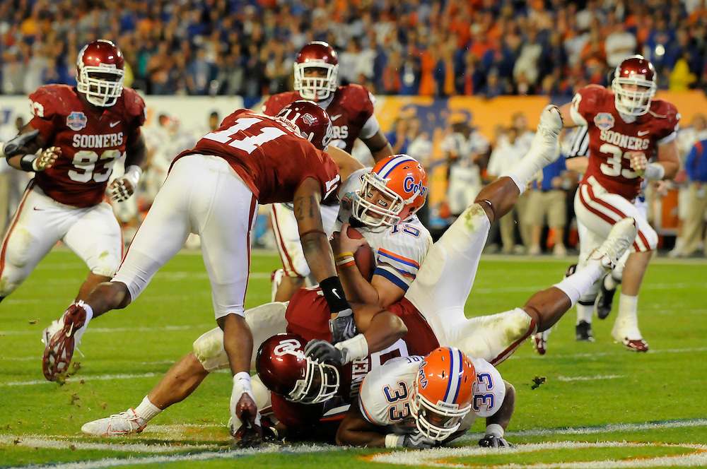 January 8, 2009: Tim Tebow of the Florida Gators is tackled by Lendy Holmes of the Oklahoma Sooners during the NCAA football game between the Florida Gators and the Oklahoma Sooners in the 2009 BCS National Championship Game. The Gators defeated the Sooners 24-14.