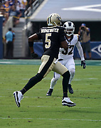 New Orleans Saints quarterback Teddy Bridgewater (5) runs with the ball during an NFL football game against the Los Angeles Rams, Sunday, Sept. 15, 2019, in Los Angeles. The Rams defeated the Saints 27-9. (Dylan Stewart/Image of Sport)