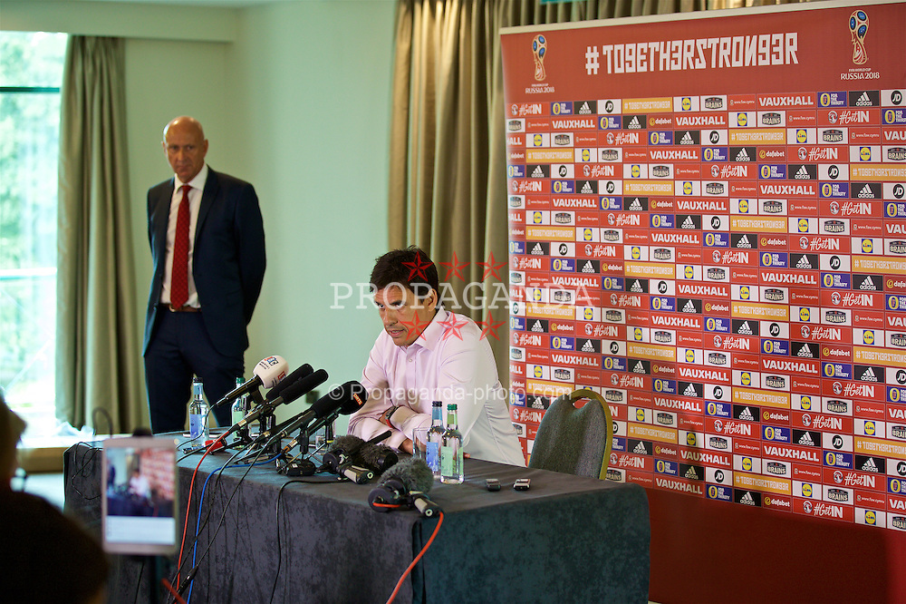 CARDIFF, WALES - Wednesday, August 24, 2016: Wales' manager Chris Coleman and head of pubic affairs Ian Gwyn Hughes during a press conference at the Vale Resort to announce his squad for the opening 2018 FIFA World Cup Qualifying Group D match against Moldova. (Pic by David Rawcliffe/Propaganda)