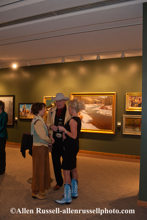 The Russell, C.M. Russell Museum Sale, Great Falls, Montana, 2011, artist Kim Monahan Dady viewing art and socializing
