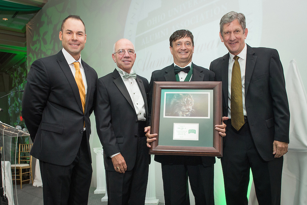 From left, Russ Eisenstein, Tom Davis, Samuel Shon and Jim Schaus pose after Shon was inducted into the Kermit Blosser Ohio Athletics Hall of Fameduring the 2016 Alumni Awards Gala at Ohio University's Baker Center Ballroom on Friday, October 07, 2016.
