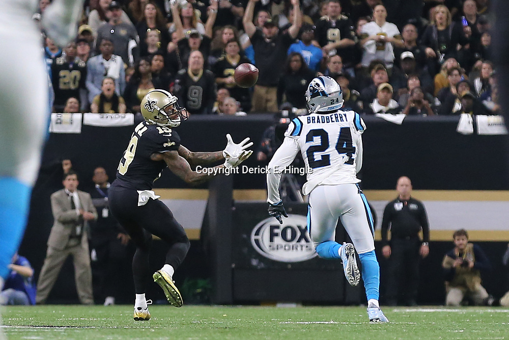 Jan 7, 2018; New Orleans, LA, USA; New Orleans Saints wide receiver Ted Ginn (19) catches a pass for a touchdown against Carolina Panthers cornerback James Bradberry (24) during the first quarter in the NFC Wild Card playoff football game at Mercedes-Benz Superdome. Mandatory Credit: Derick E. Hingle-USA TODAY Sports
