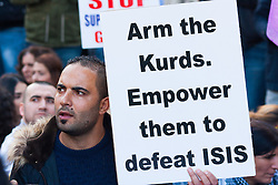 London, October 11th 2014. Thousands of protesters from the UK's Kurdish community demonstrate in London against the delay in assisting the people of the Syrian city of Kobane in their fight against ISIS. They also accuse Turkey, with whom the Kurds have had a long-running insurgency of siding with the Islamic State by doing nothing to help Kurds in Kobane. PICTURED: A protester demands that Kurds are armed by the west so they can fight on a level playingfield against the sophisticated weaponry of ISIS.