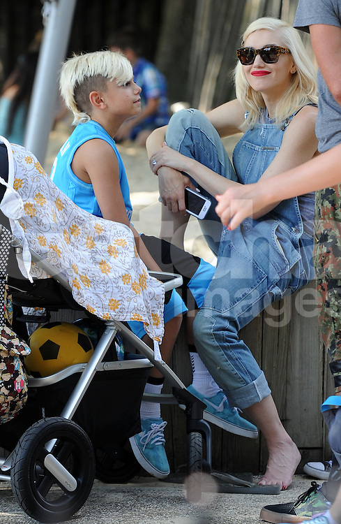 Singer Gwen Stefani, Gavin Rossdale and their three boys Kingston Rossdale, Zuma Nesta Rock Rossdale, Apollo Bowie Flynn Rossdale  enjoy a day out at a London park, UK. 22/07/2014<br />