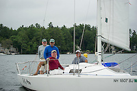 The crew on Jolly Mon Ed Philpot, Jack Donohue, Larry Routhier and Kevin Coons prepare to set sail out of Saunders Bay from Winnipesaukee Yacht Club for the JBT Memorial Race for the Cure on Saturday morning. (Karen Bobotas/for the Laconia Daily Sun)