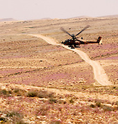 Israel, Negev, Israeli military helicopter flying over the negev desert