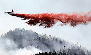 A heavy air tanker drops fire retardant on the High Park fire west of Fort Collins, Colorado June 19, 2012.  REUTERS/Rick Wilking  (UNITED STATES)