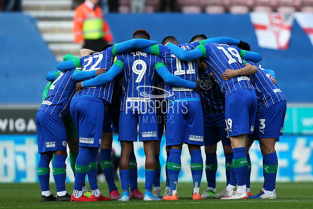 Wigan Athletic hudle during the EFL Sky Bet Championship match between Wigan Athletic and Nottingham Forest at the DW Stadium, Wigan, England on 20 October 2019.