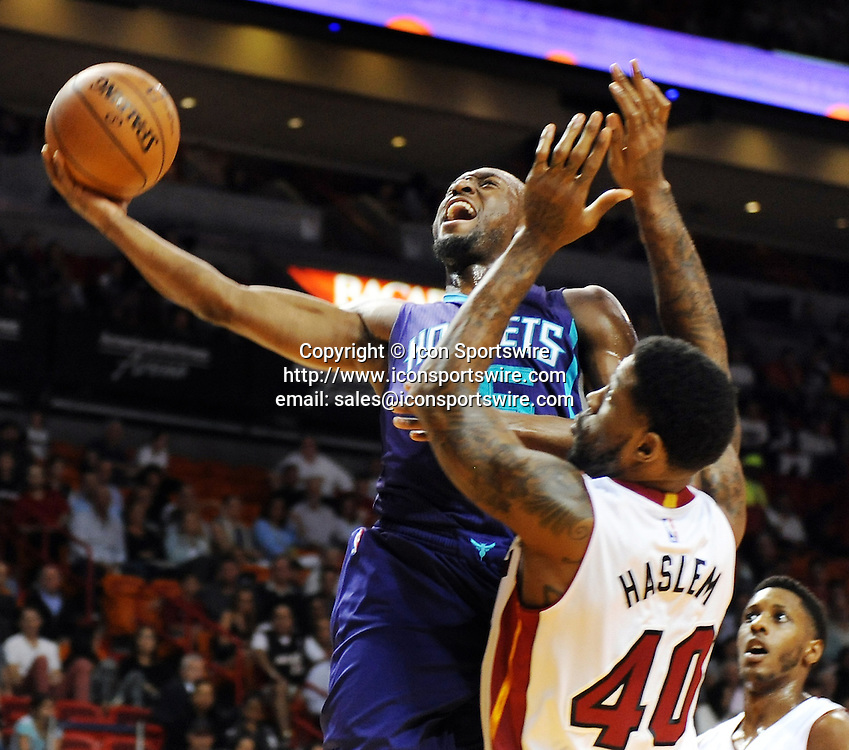 Nov. 23, 2014 - Miami, FL, USA - Charlotte Hornets' Al Jefferson drives to the basket while guarded by Miami Heat's Udonis Haslem during the first quarter on Sunday, Nov. 23, 2014, at AmericanAirlines Arena in Miami.