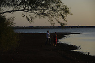 lovers throwing stones at lake hefner in Oklahoma City.