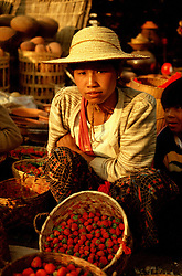 BURMA TAUNGGYI MAR95 - A tribal woman sits next to baskets of strawberries that she sells on the weeklt tribal market. . . jre/Photo by Jiri Rezac. . © Jiri Rezac 1995. . Contact: +44 (0) 7050 110 417. Mobile: +44 (0) 7801 337 683. Office: +44 (0) 20 8968 9635. . Email: jiri@jirirezac.com. Web: www.jirirezac.com