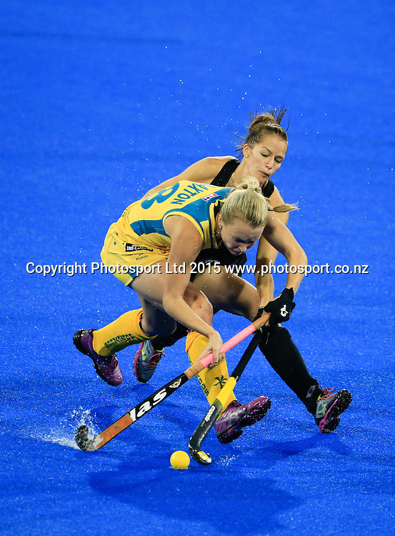 New Zealand's Petrea Webster tackles Ashleigh Nelson. New Zealand Black Sticks Women v Australia, Final, Festival of Hockey, Unison Hockey Stadium, Hastings, New Zealand. Sunday, 19 April, 2015. Copyright photo: John Cowpland / www.photosport.co.nz