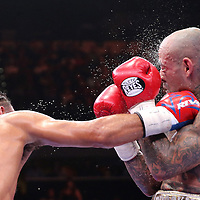 Keith Thurman (L)  land a right hand to the neck of Luis Collazo during their Premier Boxing Champions boxing match for the WBA Welterweight title on ESPN at the USF Sun Dome, on Saturday, July 11, 2015 in Tampa, Florida.  Thurman won the bout when the corner of Collazo stopped the fight at the beginning of the eighth round. (AP Photo/Alex Menendez)