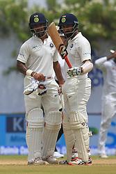 July 26, 2017 - Galle, Sri Lanka - Indian cricketer ..Cheteshwar Pujara(R) raises his bat after scoring 50 runs as his partner Shikhar Dhawan looks on during the 1st Day's in the 1st Test match between Sri Lanka and India at the Galle International cricket stadium, Galle, Sri Lanka on Wednesday 26 July 2017. (Credit Image: © Tharaka Basnayaka/NurPhoto via ZUMA Press)