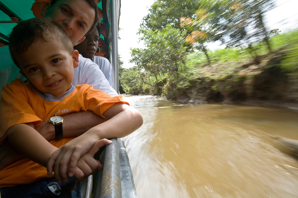 A child and his father on the taxi boats that acts as transportation in Tortuguero. Located on the Caribbean coast of Costa Rica, Tortuguero is well known for the nesting turtles on its beaches as well as its diverse wildlife along its rivers banks.