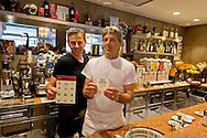 """Roma 23 Maggio 2015<br /> La Campagna Slotmob contro la diffusione del gioco d'azzardo legalizzato a organizzata una marcia nel quartiere Tiburtino consegnando degli adesivi ai bar slot-free che hanno rinunciato agli introiti dell'azzardo per un puro gesto di responsabilità, e che sono stati premiati, con una colazione di massa,  dei partecipanti alla marcia. Il titolare del Bar Monaco riceve l'adesivo """"bar slot-free""""<br /> Rome May 23, 2015<br /> Campaign Slotmob against the spread of legalized gambling in a march organized in the district Tiburtino delivering stickers to bar slot-free that they gave up to the revenue of chance for a pure gesture of responsibility  and have been rewarded with a Breakfast mass of marchers. The owner of Bar Monaco receives the sticker """"bar slot-free"""""""