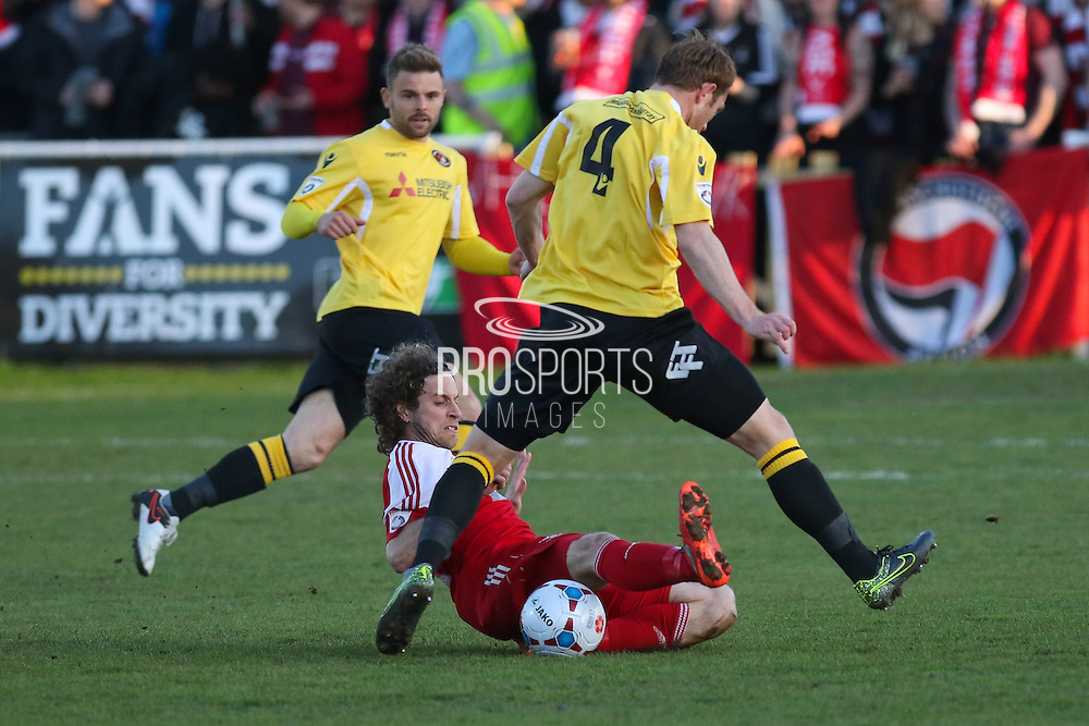 Whitehawk midfielder Sergio Torres tackles Stuart Lewis of Ebbsfleet during the National League South Play Off 1st Leg match between Whitehawk FC and Ebbsfleet United at the Enclosed Ground, Whitehawk, United Kingdom on 4 May 2016. Photo by Phil Duncan.