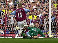 Photo: Greig Cowie.<br /> 20/09/2003.<br /> Barclaycard Premiership. Aston Villa v Charlton Athletic.<br /> Dean Kiely keeps out Marcus Allback from point Blank range