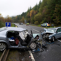 Three Die in Fatal Road Collison on the A9 north of Pitlochry near Killicrankie.....22.10.10  <br /> Police investigators inspect the two vehicles in which the people died. The collision happened on a single carriageway stretch of the A9, one mile north of the Killiecrankie turnoff. The driver of the Volvo S80 who was travelling south was pronounced dead at the scene along with the two occupants of the Vauxhall Astra which was heading north.<br /> Picture by Graeme Hart.<br /> Copyright Perthshire Picture Agency<br /> Tel: 01738 623350  Mobile: 07990 594431
