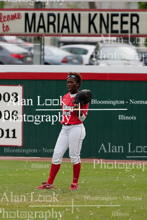 15 April 2012:  Nichelle Harrison stands under the Marian Kneer sign in right field waiting for a an inning to begin during an NCAA women's softball game between the Drake Bulldogs and the Illinois State Redbirds on Marian Kneer Field in Normal IL