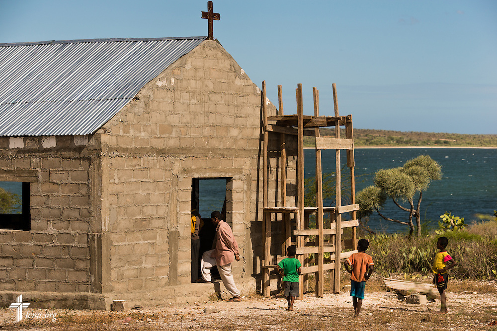 Congregation members arrive at a Fiangonana Loterana Malagasy (FLM, Malagasy Lutheran Church) church near Antsovela, southern Madagascar on Monday, Oct. 20, 2014. The church was able to expand for a larger congregation and add a longer roof thanks to tin roofs provided by The Lutheran Church-Missouri Synod.  LCMS Communications/Erik M. Lunsford
