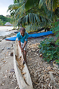 Man building Outrigger canoe, Kioa Island Fiji