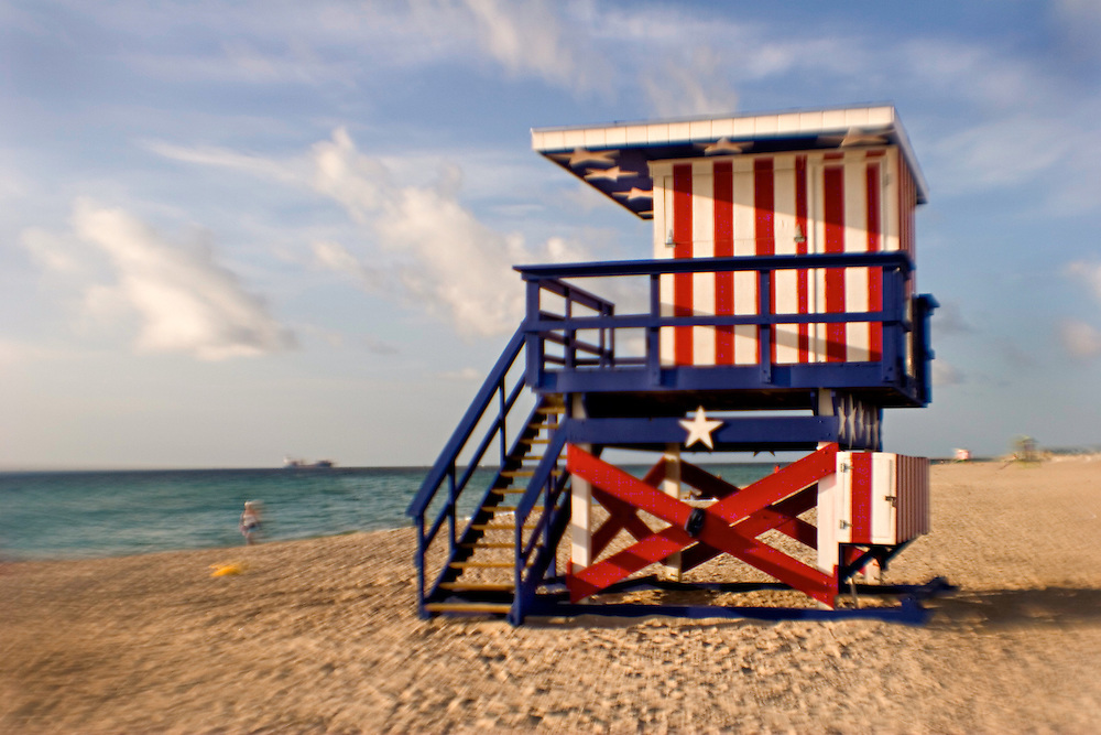 patriotic colorful lifeguard stand  greets a new day in the tropical early morning light on Miami South Beach