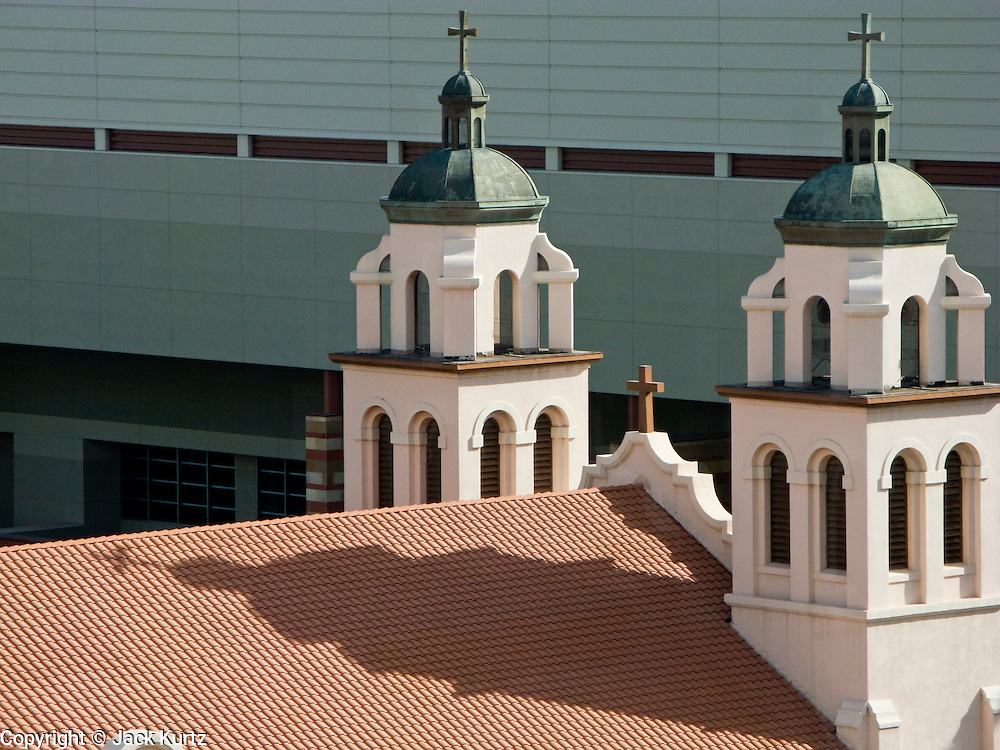 02 DECEMBER 2008 -- PHOENIX, AZ: St. Mary's Basilica in Phoenix, AZ, is one of the oldest Catholic churches in Phoenix. The church, which once dominated the Phoenix skyline, is now dwarfed by the new Phoenix Convention Center, which is in the background. PHOTO BY JACK KURTZ